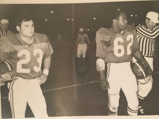 Lansing All-Star teammates Tom Eifert (left) and Charles Thronhill (right) wait for kick-off. Thornhill was a former All-Big Ten defensive back for MSU during the 1966 seasonor