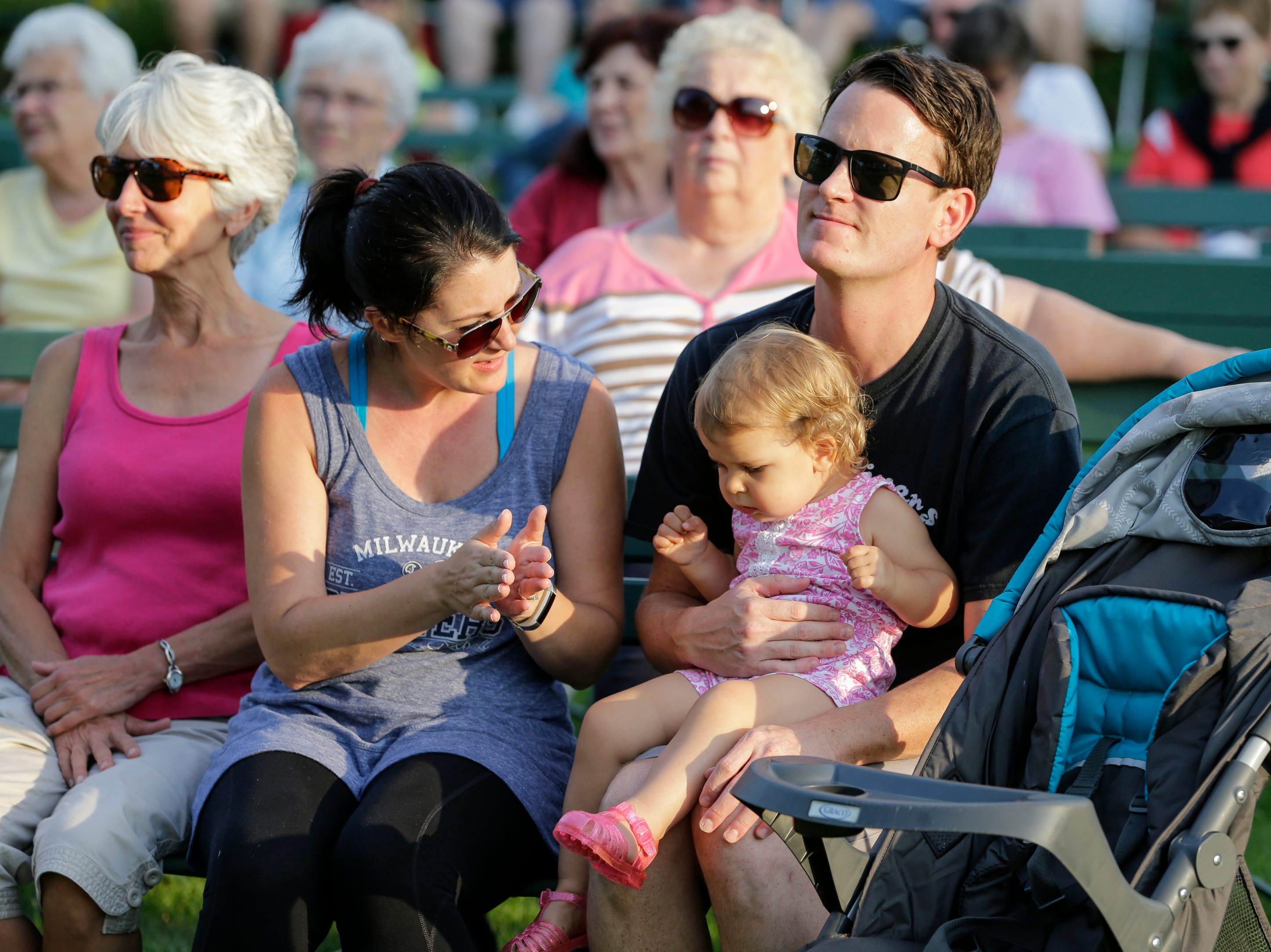 From left, Susan, Melanie, Sophia, 1, and Ryan Landers watch the Two Rivers Community Band play their final concert of the season at Central Park Thursday, August 9, 2018, in Two Rivers, Wis. Josh Clark/USA TODAY NETWORK-Wisconsin