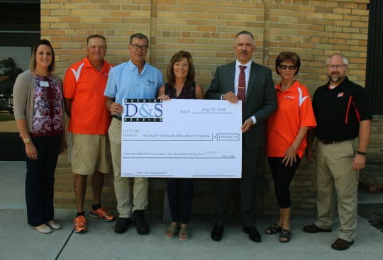 Mishicot High School on Aug. 8 received $105,690 worth of new milling equipment, courtesy of Mr. and Mrs. Russell Nowak, owners of D&S Machine Service of Luxemburg. Pictured, from left: Lorinda Tulachka, Progress Lakeshore; Bob Shimek, Mishicot school board; Mr. and Mrs. Russell Nowak, owners of D&S Machine Service; Paul Orlich, superintendent of schools; Judy Ferry, Mishicot school board; and Brennen Mickelson, technical education teacher.
