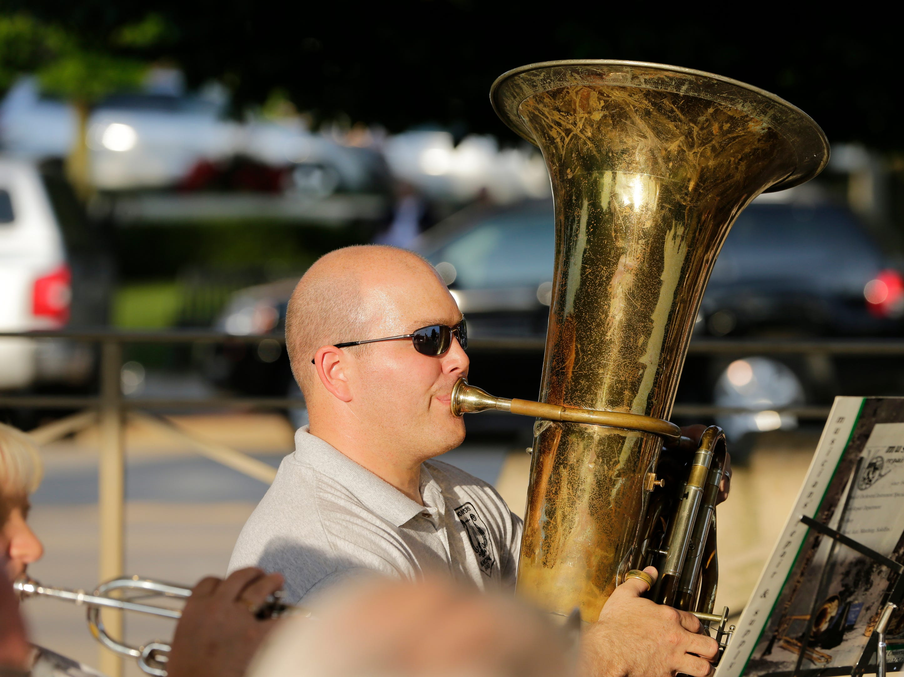 Chris Burton plays the Tuba as the Two Rivers Community Band plays their final concert of the season at Central Park Thursday, August 9, 2018, in Two Rivers, Wis. Josh Clark/USA TODAY NETWORK-Wisconsin