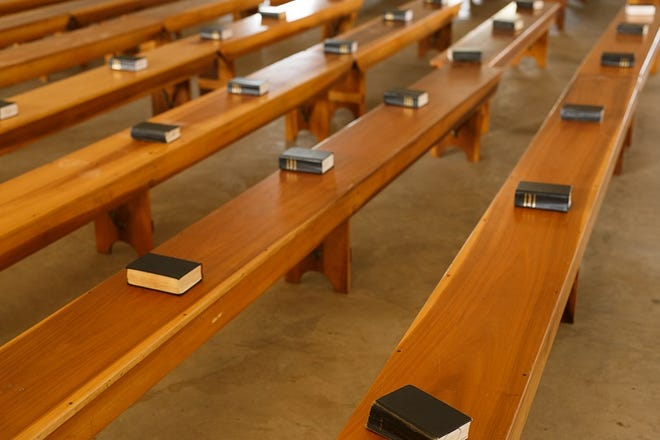 Benches and Ausbund hymnals are hauled from one home to another to use for church services in homes, pole barns or basements.