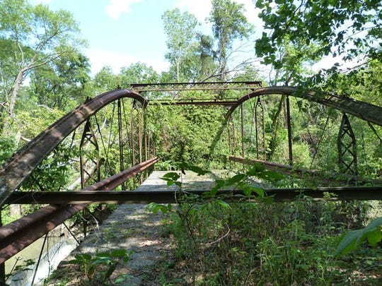 The historic bowstring bridge crossing to the Caledonia Nature Preserve.