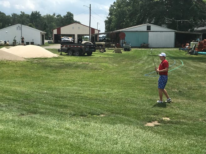 Ridgedale's Jesse Schertzer's chips onto the 18th green at Kings Mill during this year's Marion County Tournament.