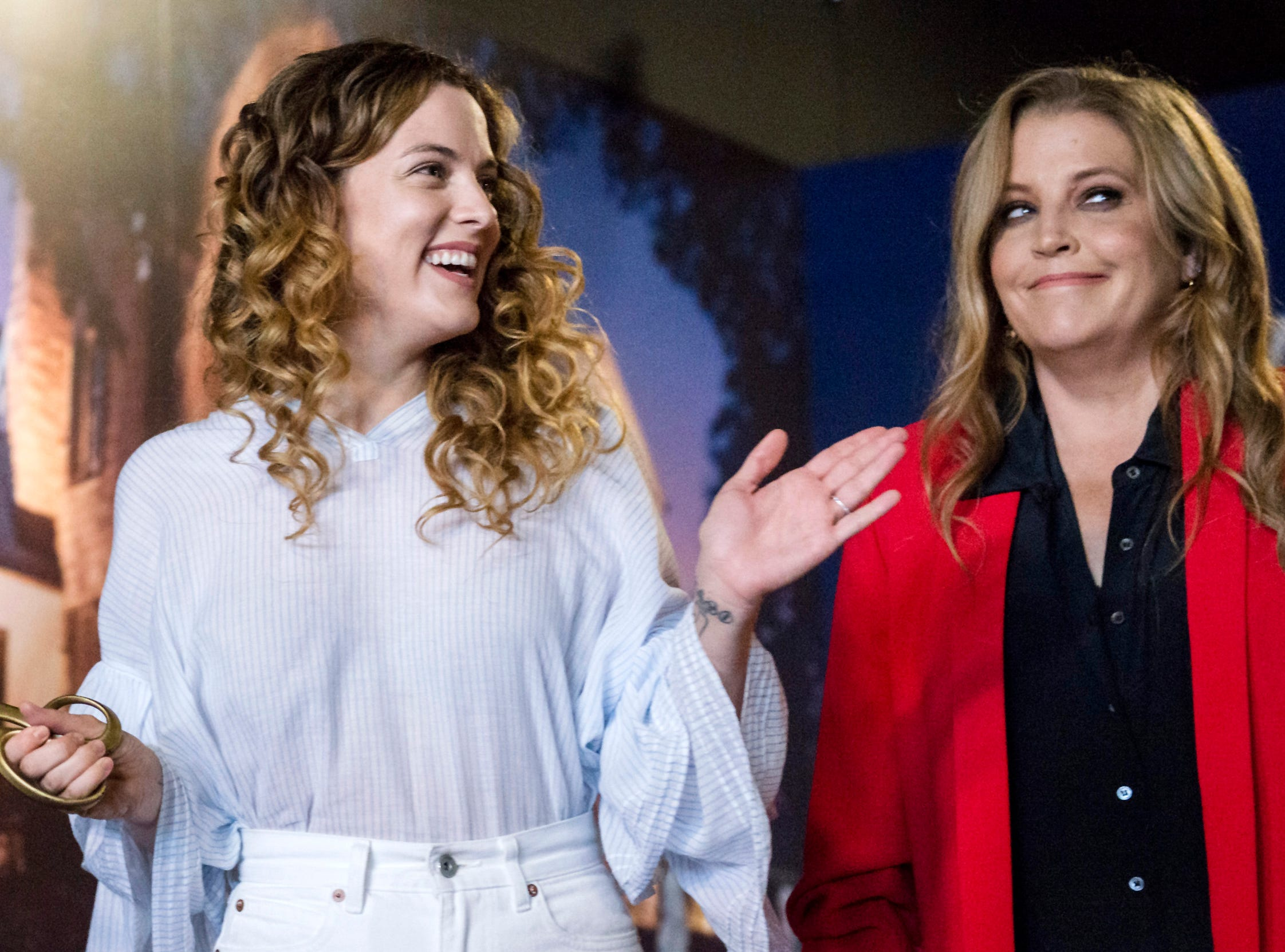 "August 10, 2018 - Lisa Marie Presley, right, and her daughter Riley Keough participate in a private ribbon-cutting event for the new exhibit ""Lisa Marie: Growing Up Presley"" at Elvis Presley's Memphis entertainment complex."
