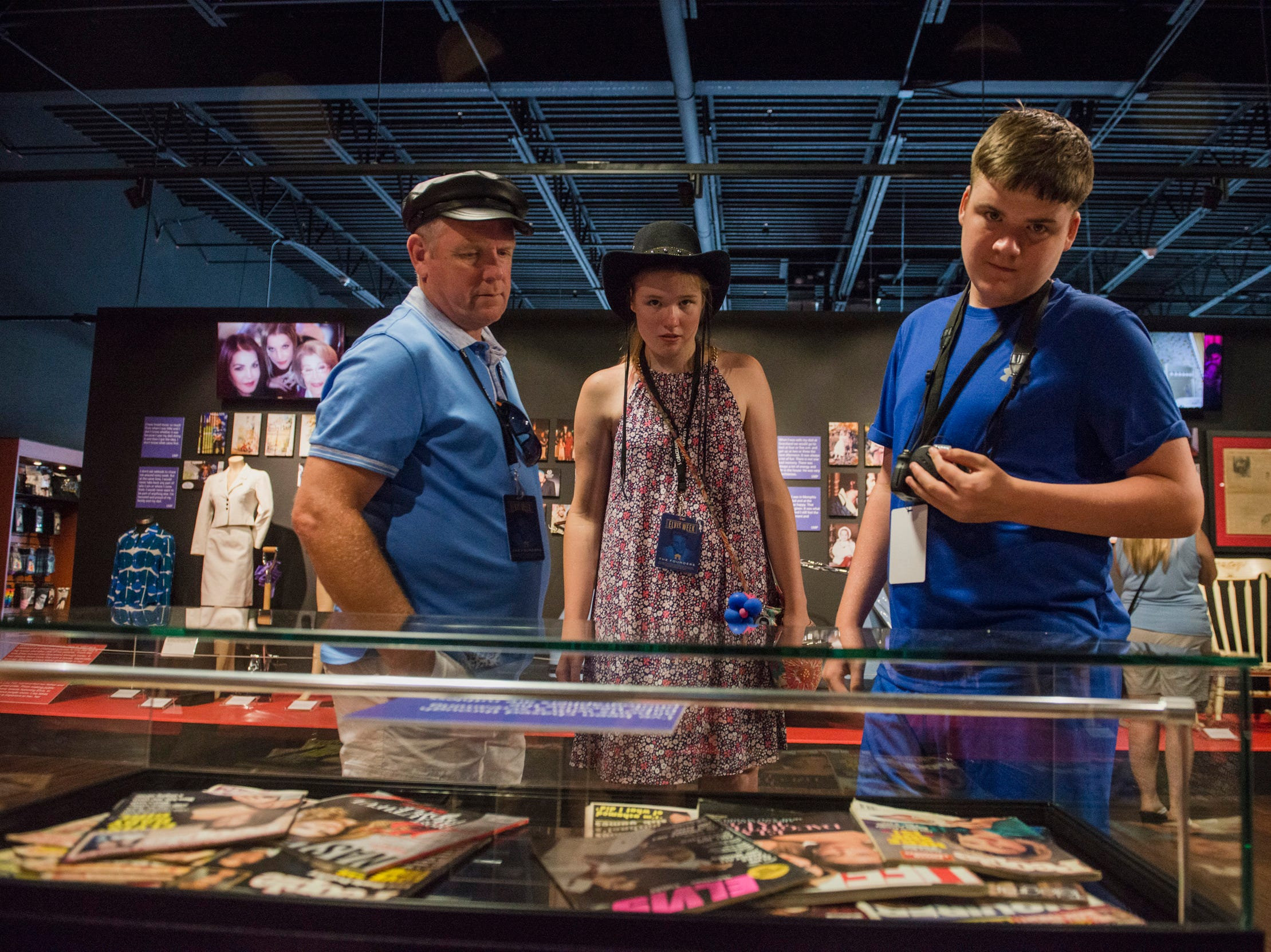 "August 10, 2018 - David Greenwood, left, and his children Deedee Greenwood, 16, and Dean Greenwood, 14, all from England, look at exhibits during a private ribbon-cutting event for the new exhibit ""Lisa Marie: Growing Up Presley"" at Elvis Presley's Memphis entertainment complex."