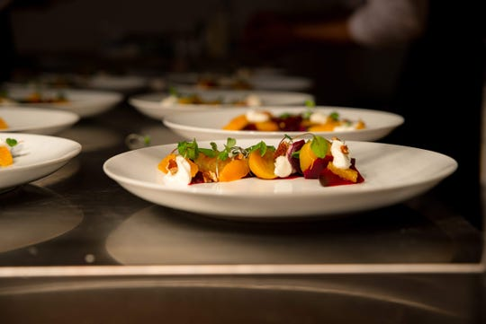 At his Taste of the Gallery pop-up dinners, Chef David Krog artfully plates each dish.
