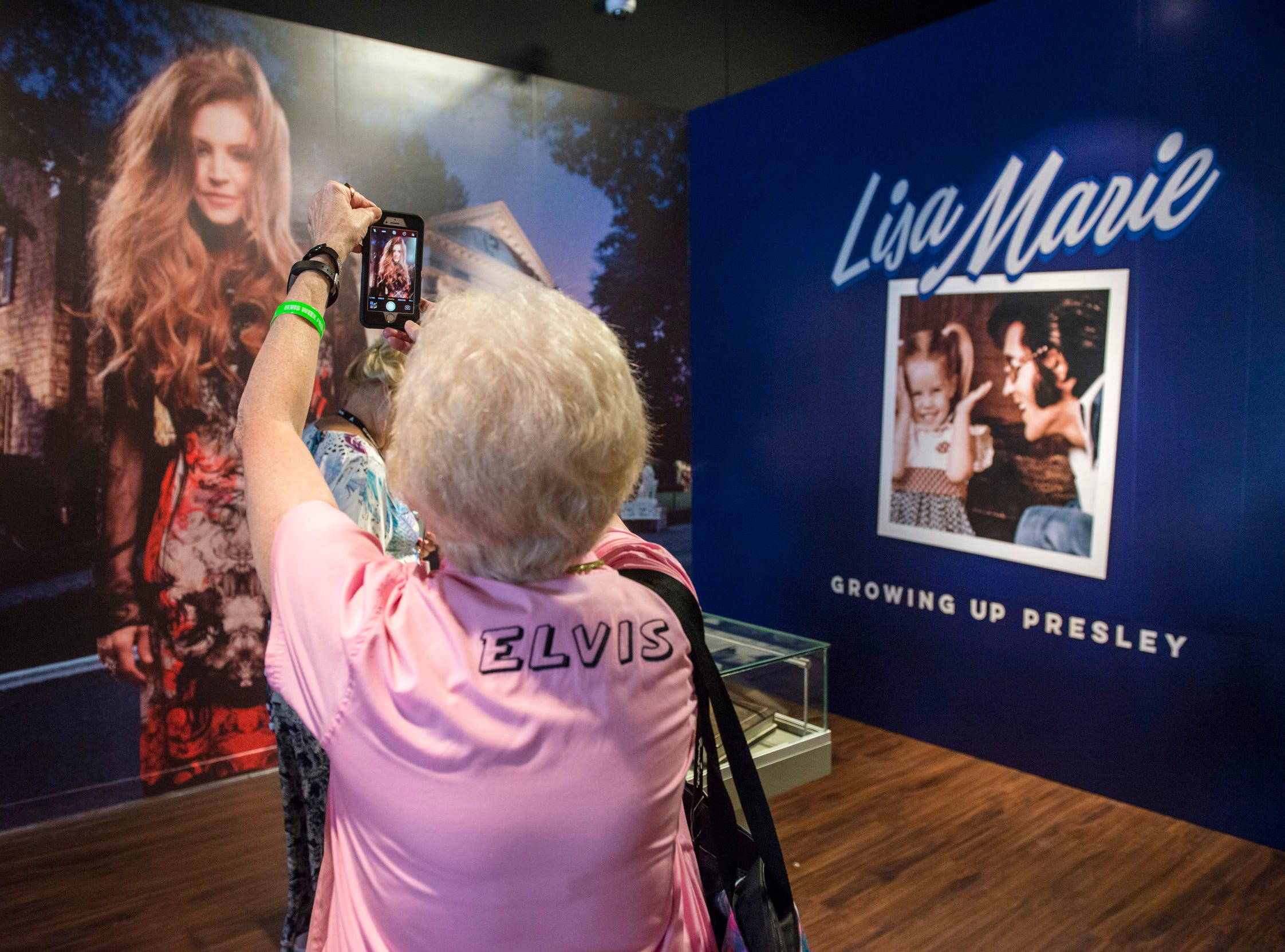 "August 10, 2018 - Jefferson City, Missouri resident Jerry Engelby takes a photo during a private ribbon-cutting event for the new exhibit ""Lisa Marie: Growing Up Presley"" at Elvis Presley's Memphis entertainment complex."