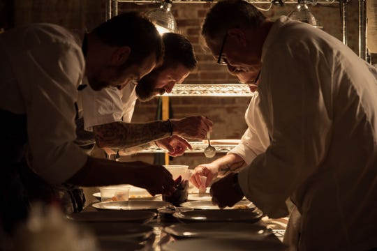 Chef David Krog and his team plate dishes for a recent Taste of Gallery pop-up dinner.