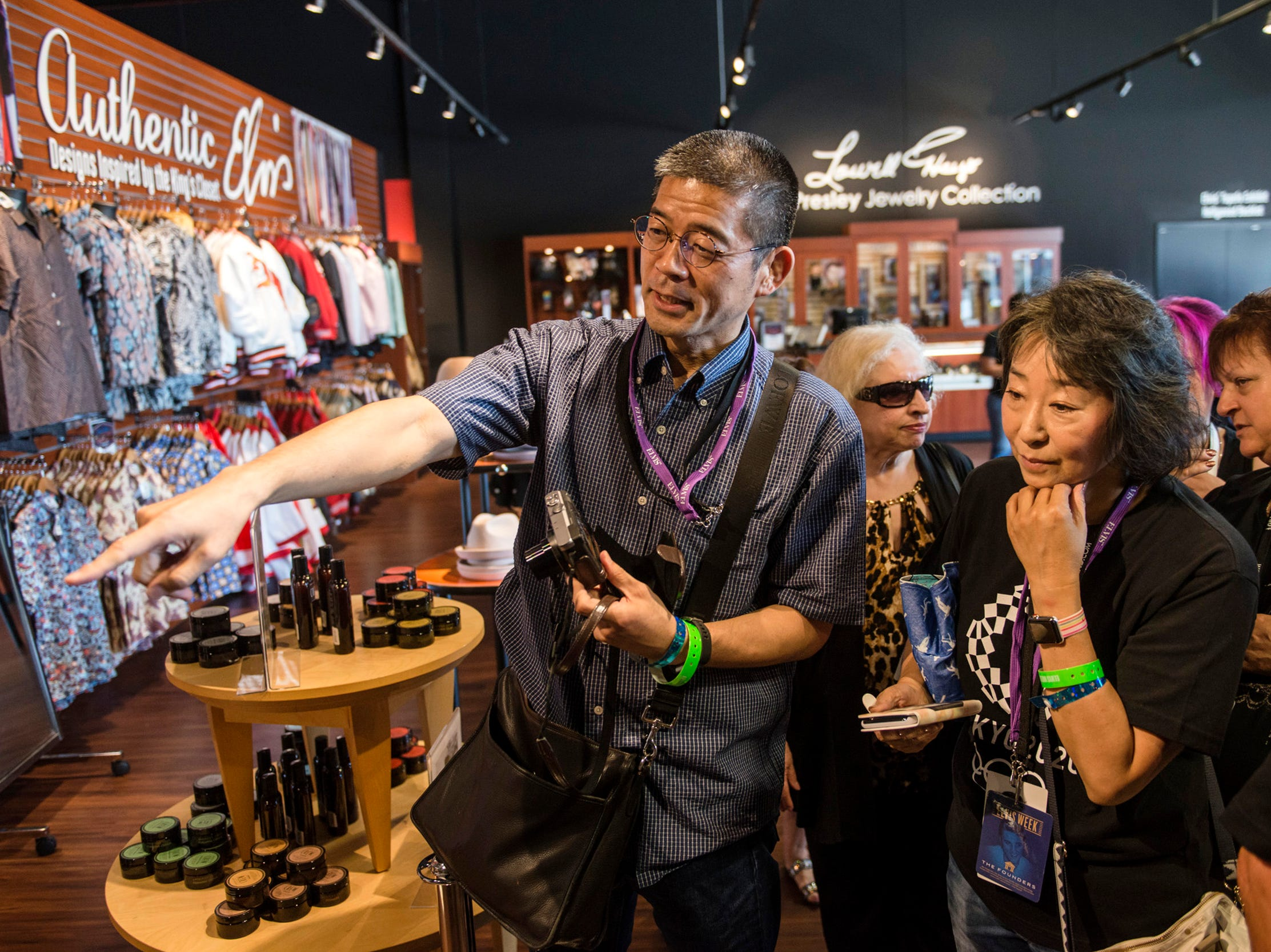 "August 10, 2018 - Satoshi Matsui, left, and Miyuki Ishikawa, both from Japan, wait during a private ribbon-cutting event for the new exhibit ""Lisa Marie: Growing Up Presley"" at Elvis Presley's Memphis entertainment complex."