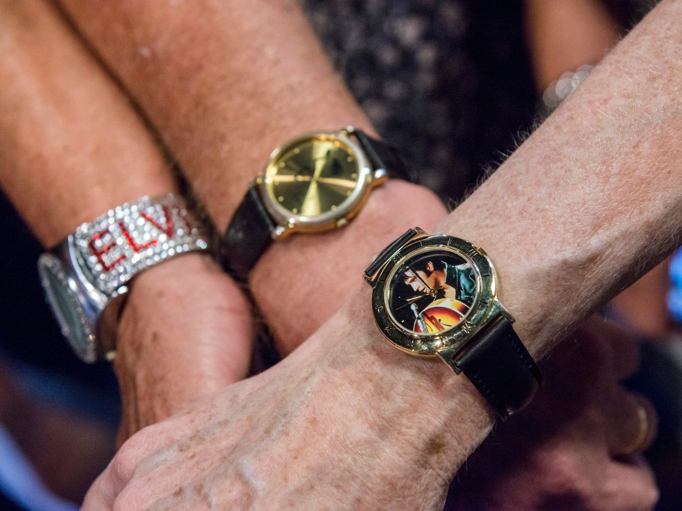 "August 10, 2018 - Fans Janice Peel, from left, Mitchell Moore, and Jerry Engelby show off their Elvis Presley-themed watches during a private ribbon-cutting event for the new exhibit ""Lisa Marie: Growing Up Presley"" at Elvis Presley's Memphis entertainment complex."