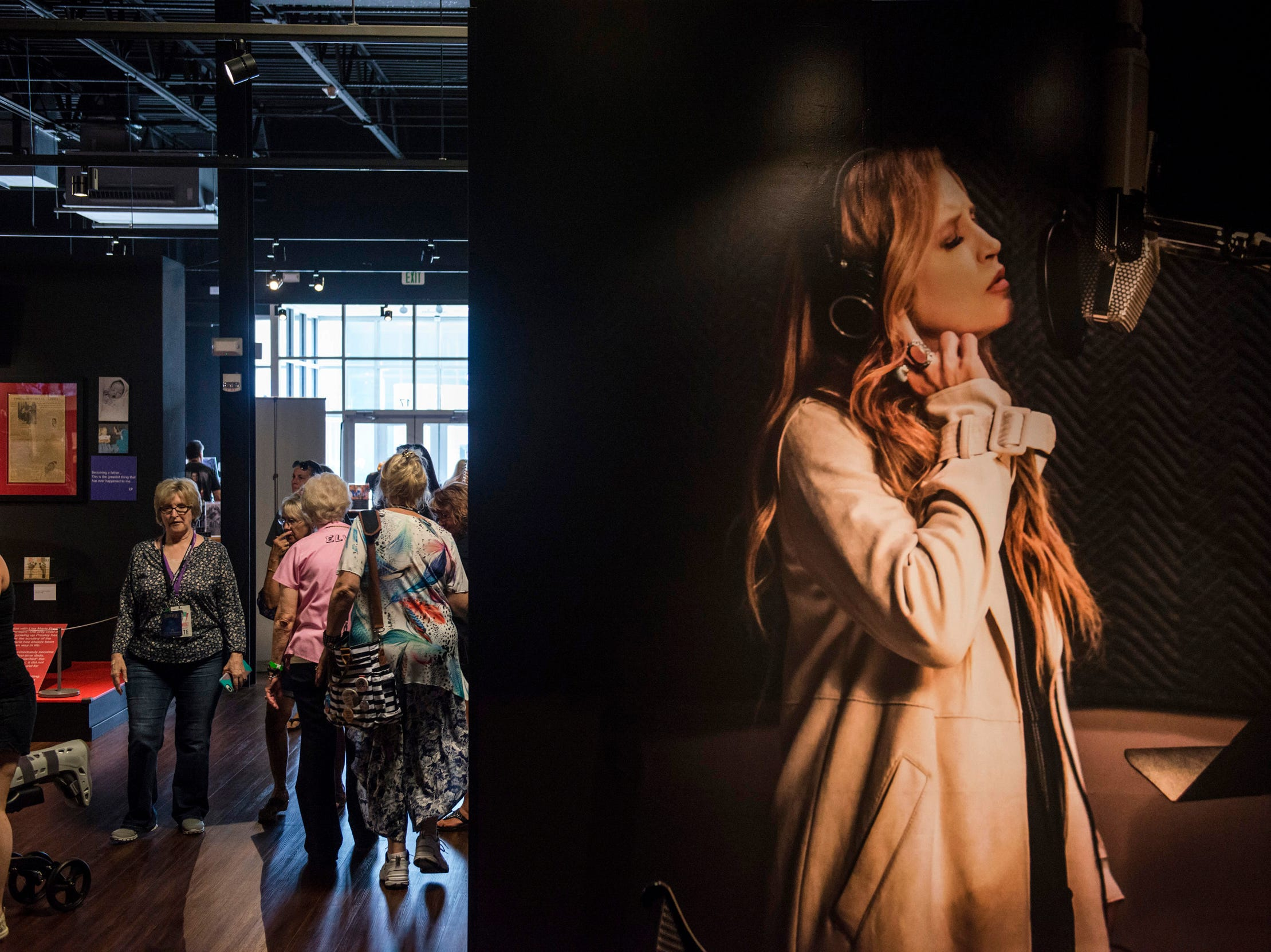 "August 10, 2018 - Fans look at ehxhibits during a private ribbon-cutting event for the new exhibit ""Lisa Marie: Growing Up Presley"" at Elvis Presley's Memphis entertainment complex."