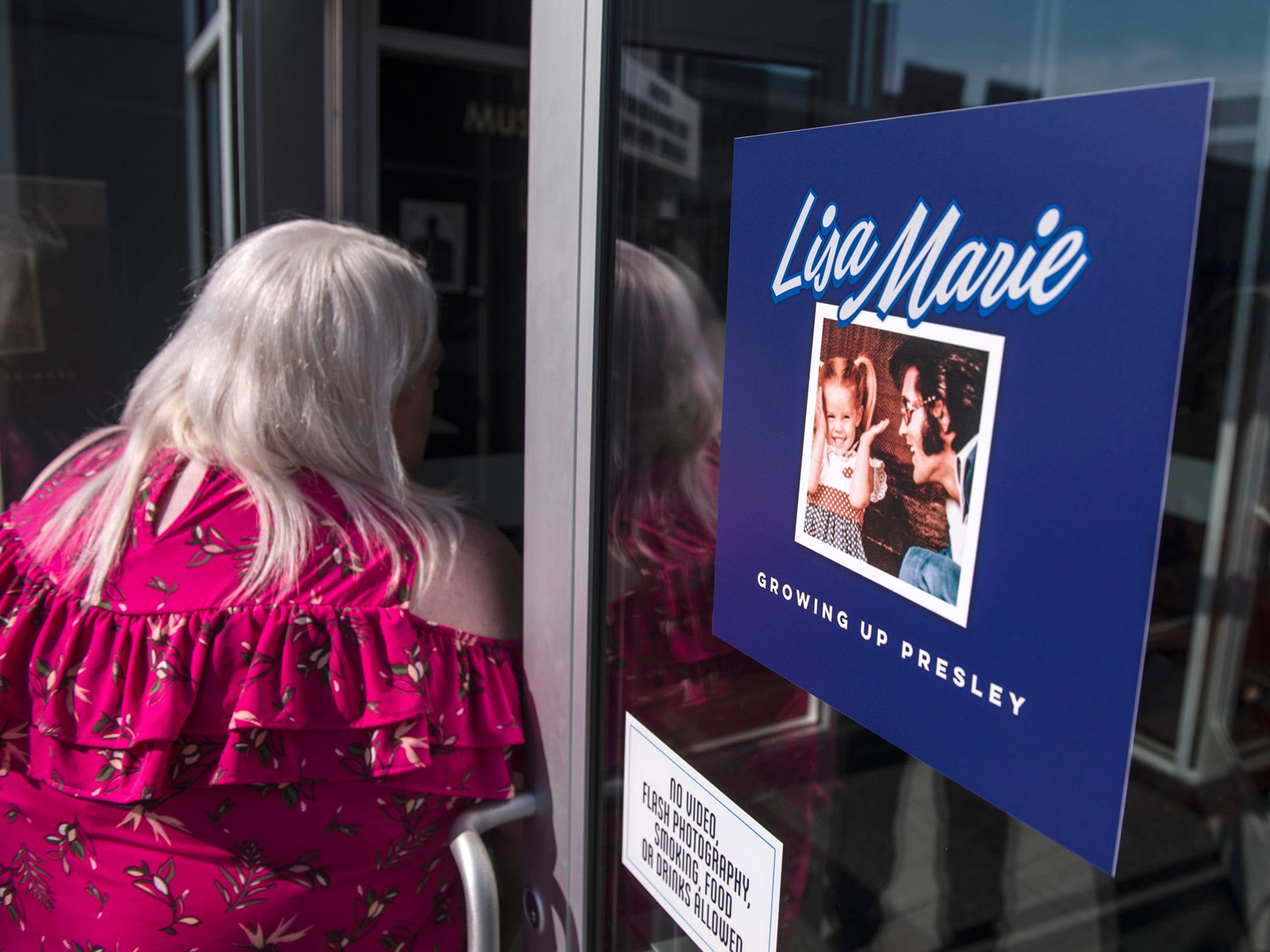 "August 10, 2018 - Fans enter a private ribbon-cutting event for the new exhibit ""Lisa Marie: Growing Up Presley"" at Elvis Presley's Memphis entertainment complex."