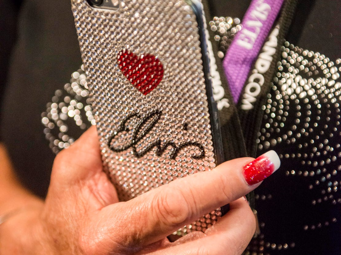 "August 10, 2018 - Canton, Texas resident Janice Peel holds her Elivs-themed cell phone while watingin before a private ribbon-cutting event for the new exhibit ""Lisa Marie: Growing Up Presley"" at Elvis Presley's Memphis entertainment complex."