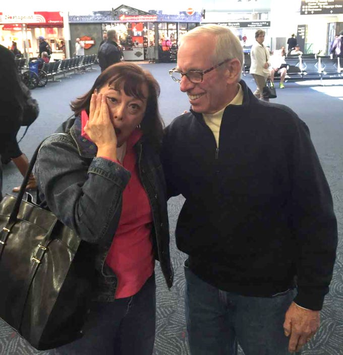 Tom Peters had not seen his daughter Mary Jane Millehan since she was an infant in 1963, but this photo shows them being reunited in 2015 at Mitchell International Airport. Peters' wife left him for another man, taking the baby with her and leaving him with the false impression that he was not the father.