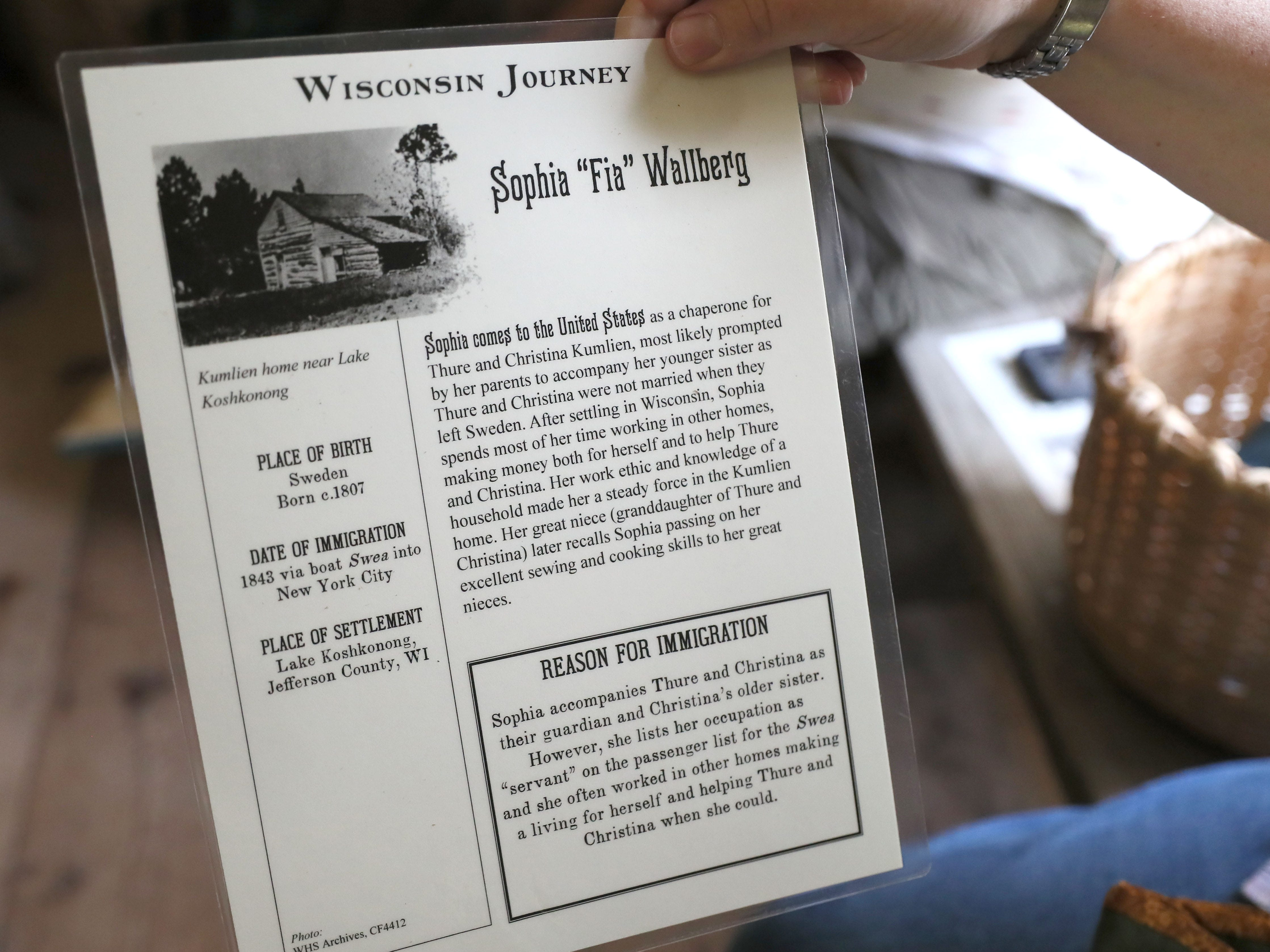 "Visitors participating in ""Wisconsin Journey"" are given information cards on actual Wisconsin immigrants and learn how those immigrants experienced life in a new land."