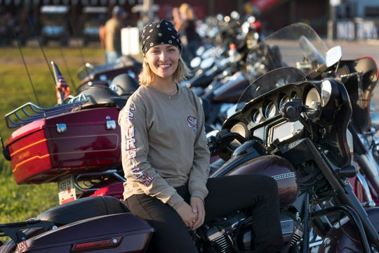Harley-Davidson intern Tess Otto sits on her company-issued motorcycle at the Pappy Hoel Campground & Resort in Vale, S.D. She gets to keep the motorcycle after her internship.