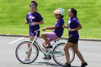 Volunteers taught people with special needs to ride bicycles independently at a five-day camp.
