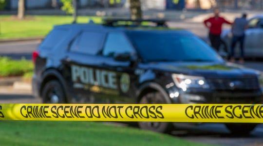 Montgomery police car and crime scene tape
