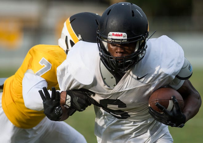 Raymond Cutler carries the ball as Autauga Academy holds a scrimmage on their campus in Prattville, Ala. on Thursday August 9, 2018.