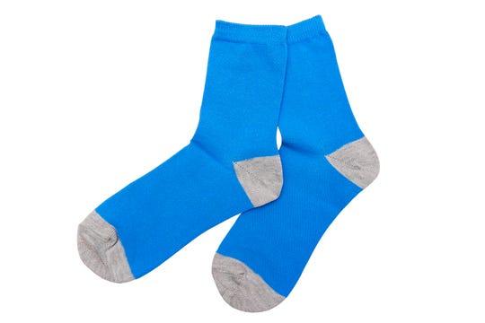 Blue socks isolated on the white background