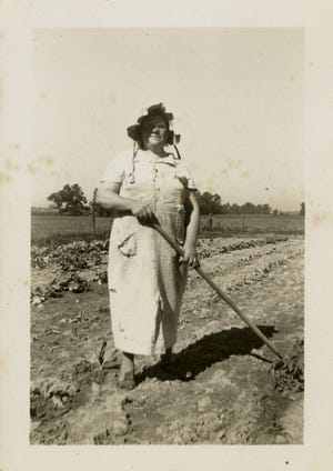 Maude Russel tends her garden near Shideler, Ind., in this vintage photo.