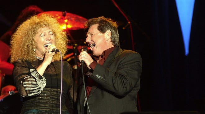Jennie Devoe and Carl Storie sing during an earlier United Voices Concert to benefit the United Way of Delaware County.