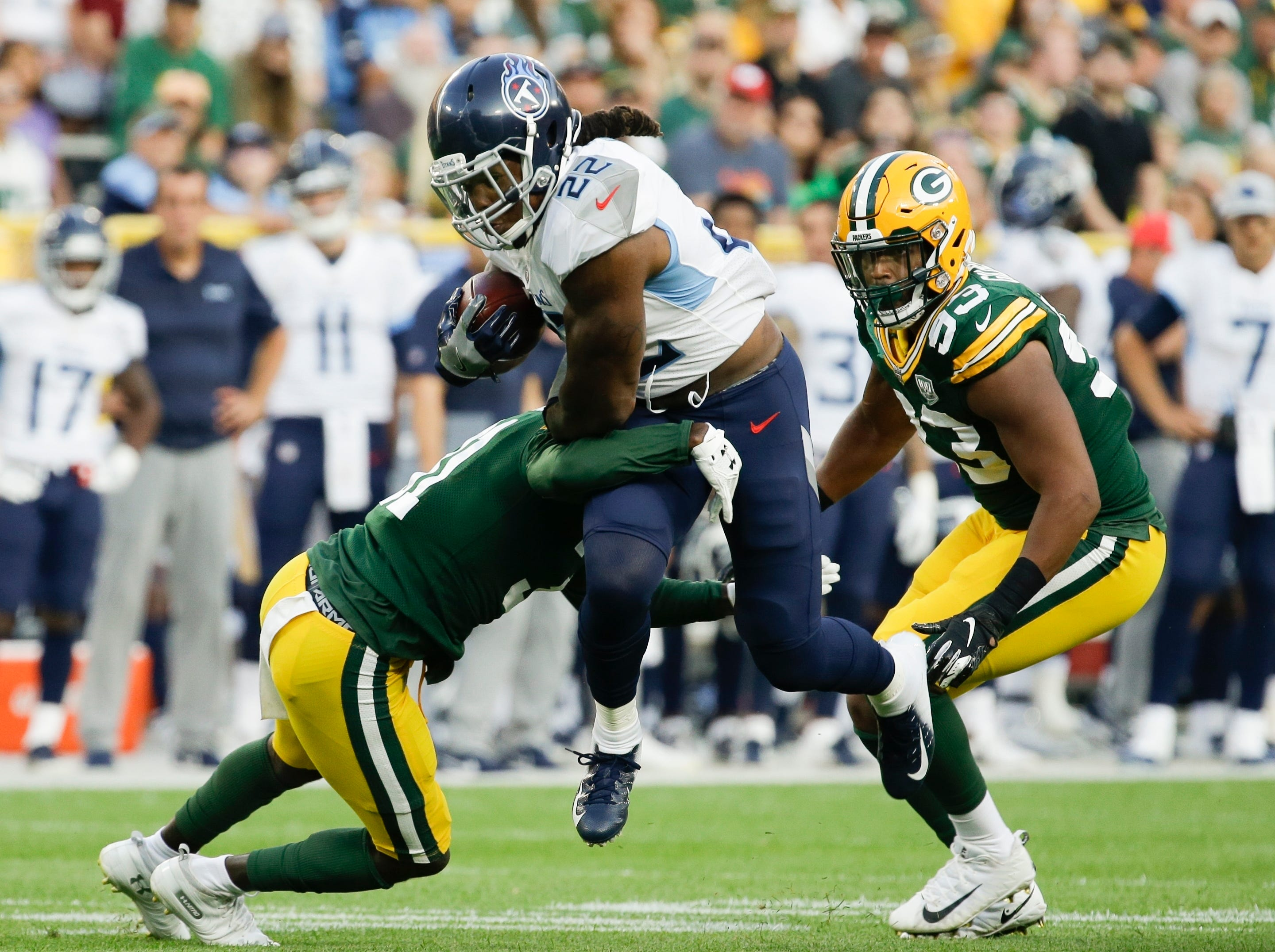 Tennessee Titans' Derrick Henry runs during the first half of a preseason NFL football game against the Green Bay Packers Thursday, Aug. 9, 2018, in Green Bay, Wis. (AP Photo/Mike Roemer)