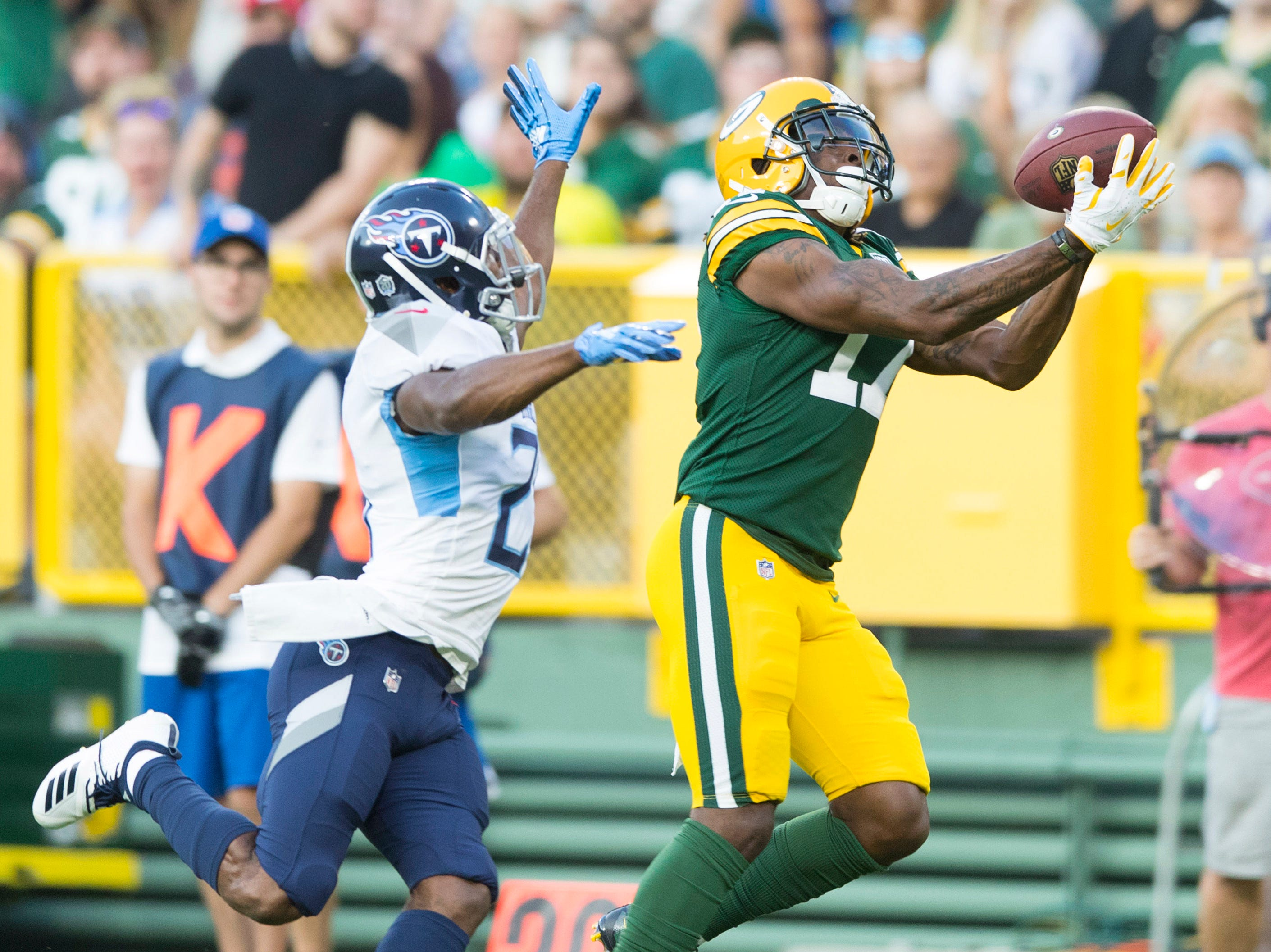 Aug 9, 2018; Green Bay, WI, USA; Green Bay Packers wide receiver Davante Adams (17) catches a pass during the first quarter against the Tennessee Titans at Lambeau Field. Mandatory Credit: Jeff Hanisch-USA TODAY Sports