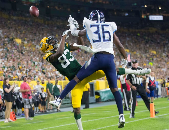 Aug 9, 2018; Green Bay, WI, USA; Green Bay Packers wide receiver Marquez Valdes-Scantling (83) is unable to catch a pass for a touchdown as Tennessee Titans cornerback LeShaun Sims (36) defends during the second quarter at Lambeau Field.