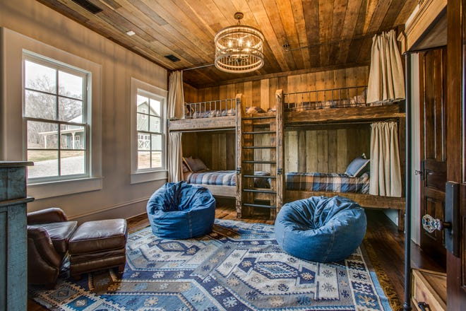 These built-in bunk beds were added to a historic home that was recently renovated. These beds are extra long to comfortably sleep tall teenagers or adults.