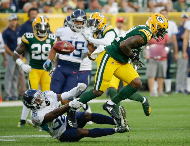 Green Bay Packers' Quinten Rollins fumbles a punt as he is hit by Tennessee Titans' LeShaun Sims during the first half of a preseason NFL football game Thursday, Aug. 9, 2018, in Green Bay, Wis. (AP Photo/Mike Roemer)