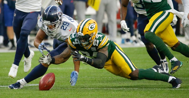 The Packers' Quinten Rollins recovers his fumble in front of the Titans' Dane Cruikshank during the first half of a preseason game Aug. 9.