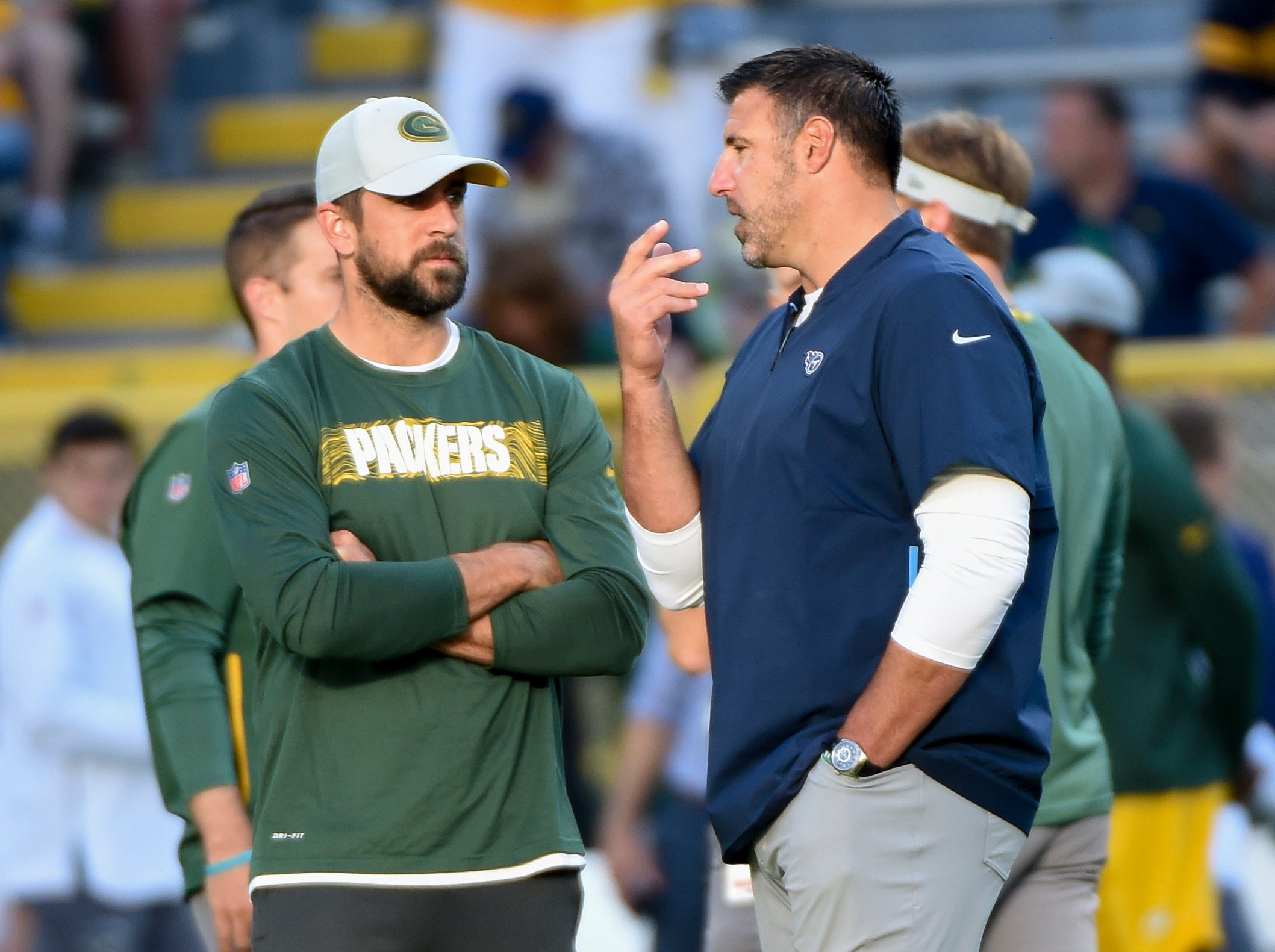 Aug 9, 2018; Green Bay, WI, USA;  Green Bay Packers quarterback Aaron Rodgers (12) talks to Tennessee Titans head coach Mike Vrabel before the game at Lambeau Field. Mandatory Credit: Benny Sieu-USA TODAY Sports