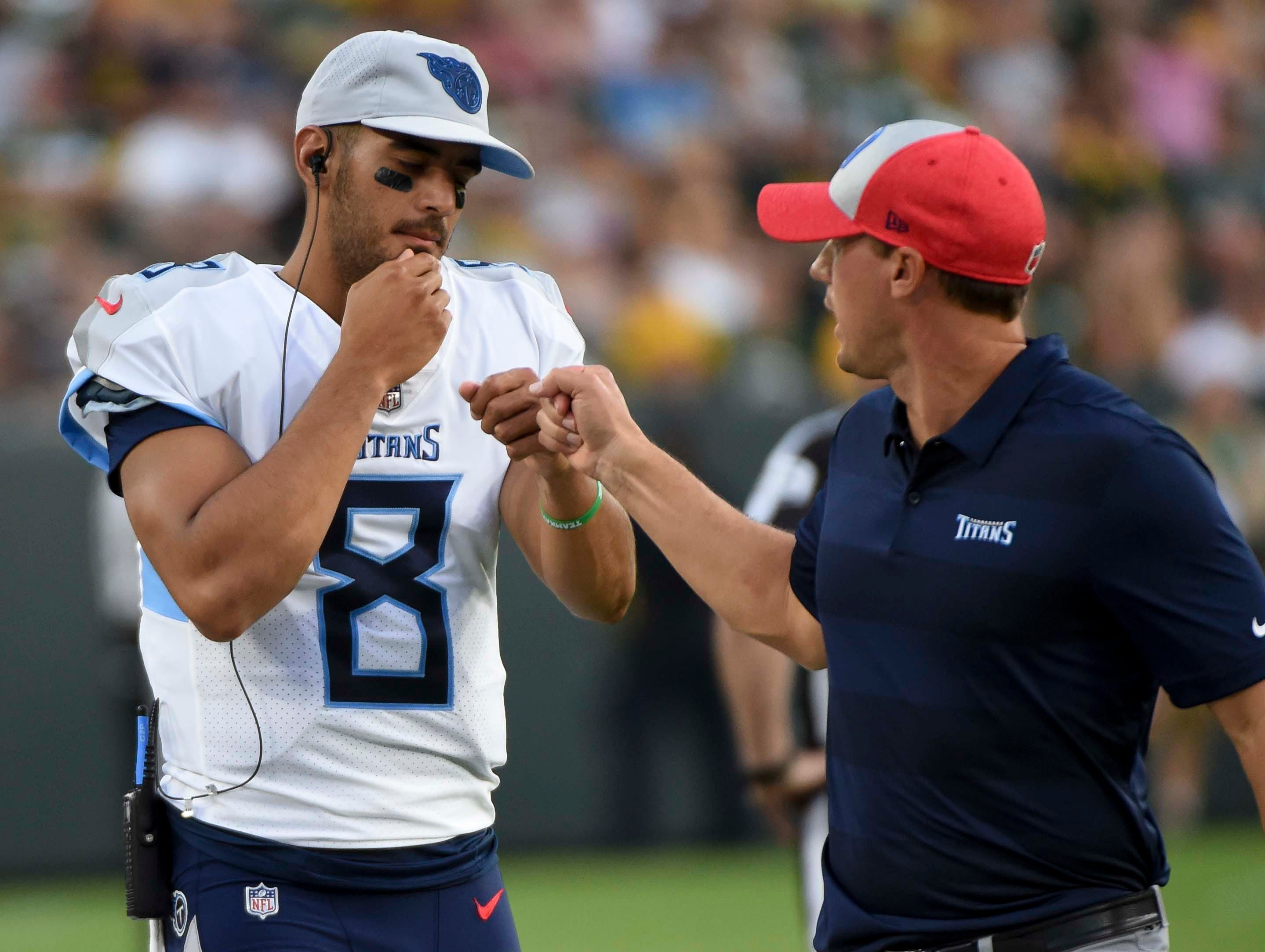 Aug 9, 2018; Green Bay, WI, USA; Tennessee Titans quarterback Marcus Mariota (8) gets a fist pump after playing the first series in game against the Green Bay Packers at Lambeau Field.