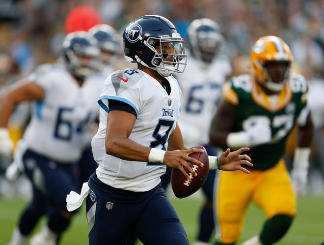 Titans quarterback Marcus Mariota scrambles during the first half of a preseason game Thursday against the Green Bay Packers.