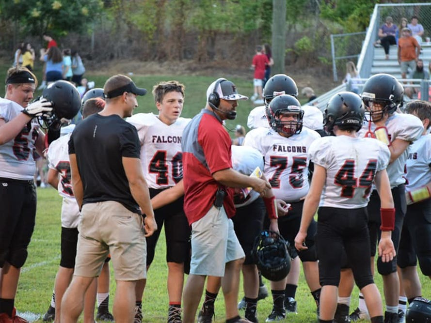 Fairview Middle School Falcons get some pre-season instruction during a recent scrimmage.
