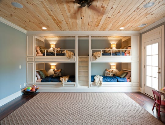 Custom builder Carbine and Associates has designed and built multiple built-in bunk beds like these, which are a great way to comfortably sleep multiple people in one room.