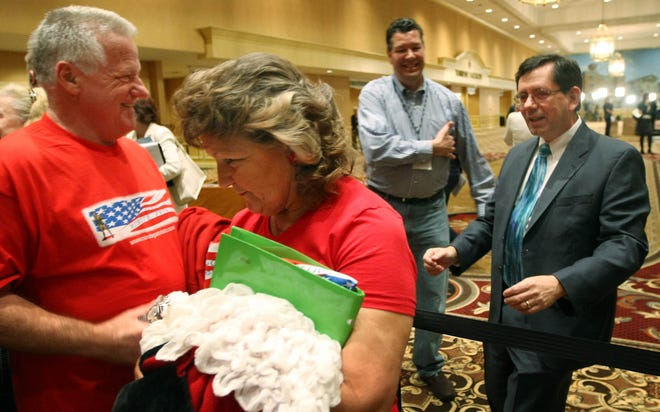 Tom and Annie Rupp of Hawaii are greeted by Tea Party Nation founder  Judson Phillips, right, during a convention Feb. 4, 2010, in Nashville.