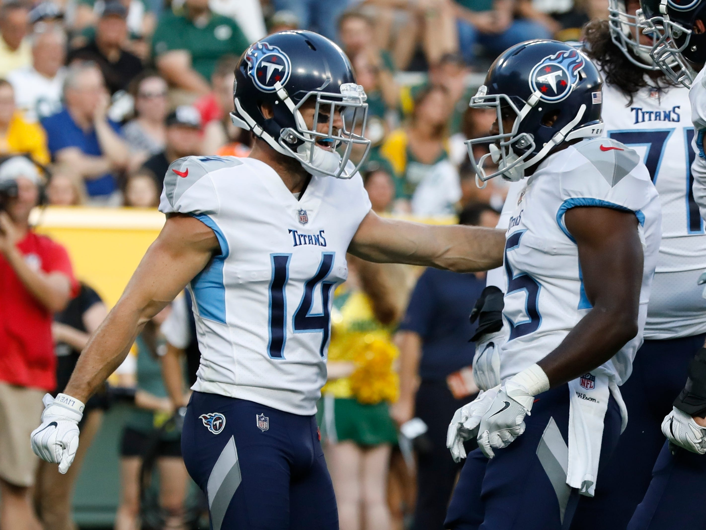 Tennessee Titans' Darius Jennings (15) is congratulated by Nick Williams after his touchdown catch during the first half of a preseason NFL football game against the Green Bay Packers Thursday, Aug. 9, 2018, in Green Bay, Wis. (AP Photo/Mike Roemer)