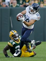 Tennessee Titans' Nick Williams catches a pass in front of Green Bay Packers' Quinten Rollins during the first half of a preseason NFL football game Thursday, Aug. 9, 2018, in Green Bay, Wis. (AP Photo/Mike Roemer)