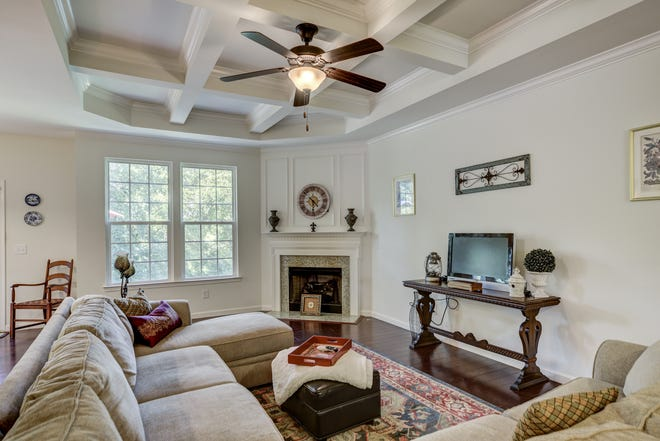 The living room of 318 Birkshire Place in Gallatin has a fireplace and hardwoods. The home is on the market for $374,900.