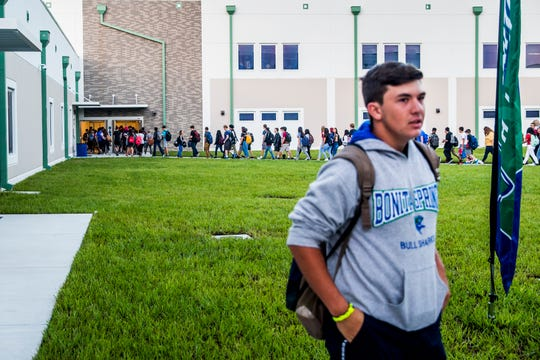 Students arrive for the first day of classes at Bonita Springs High School on Friday, Aug. 10, 2018.