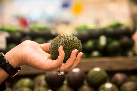 Mind body wellness practitioner and holistic nutrition specialist, Jennifer Khosla, gives insight on the ways in which she advises clients on grocery shopping during a trip to Whole Foods in Mercato on Friday, August 10, 2018. Khosla is the founder of Lean and Green Body LLC, with a mission towards advocating for a holistic approach to wellness.