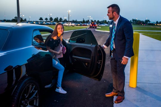 Principal Jeff Estes greets incoming sophomore Chloe Wood as she arrives for the first day of classes at Bonita Springs High School on Friday, Aug. 10, 2018.