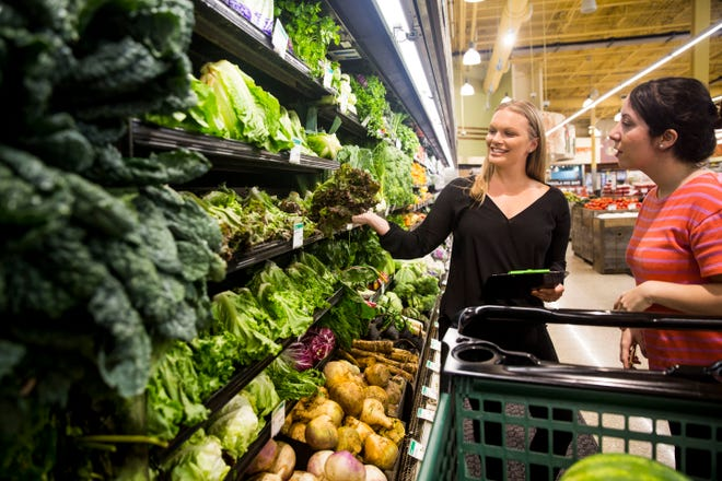 Mind body wellness practitioner and holistic nutrition specialist, Jennifer Khosla, from left, teaches Ashley Collins to keep in mind the Dirty Dozen list when grocery shopping while at Whole Foods in Mercato on Friday, August 10, 2018. Kholsa has a passion for helping her clients achieve their health and fitness goals through nutrition. Khosla is the founder of Lean and Green Body LLC, with a mission towards advocating for a holistic approach to wellness.