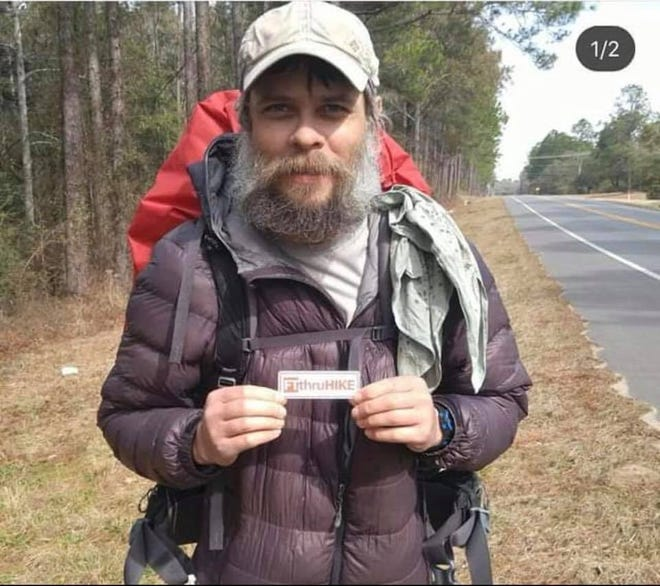 "Photo of a hiker who went by trail names ""Denim"" and ""Mostly Harmless."" He was found dead in Big Cypress National Preserve on July 23. Investigators do not know his real name."