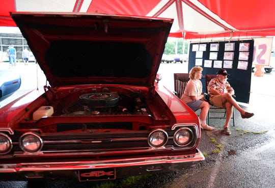 Jill and Grover Upton, of Indianapolis, sit with their 1967 Plymouth Belvedere GTS in the Mopar Nationals Survivors Tent on Friday, Aug. 10, 2018. The car was Jill's parents, Loy and Georgia Hacker, first and only new car and has only 40,000 miles on it.