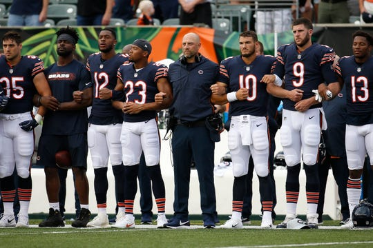 The Chicago Bears lock arms during the national anthem before the team's NFL preseason football game against the Cincinnati Bengals, Thursday, Aug. 9, 2018, in Cincinnati. (AP Photo/Frank Victores)