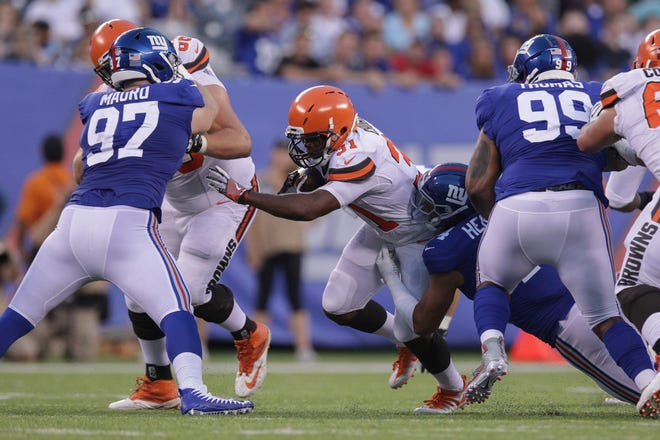 Aug 9, 2018; East Rutherford, NJ, USA; Cleveland Browns running back Nick Chubb (31) is tackled by New York Giants defensive back Grant Haley (34) during the first half at MetLife Stadium.