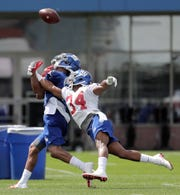 New York Giants defensive back Grant Haley (34) breaks up a pass intended for wide receiver Travis Rudolph during NFL football training camp, Thursday, July 26, 2018, in East Rutherford, N.J.